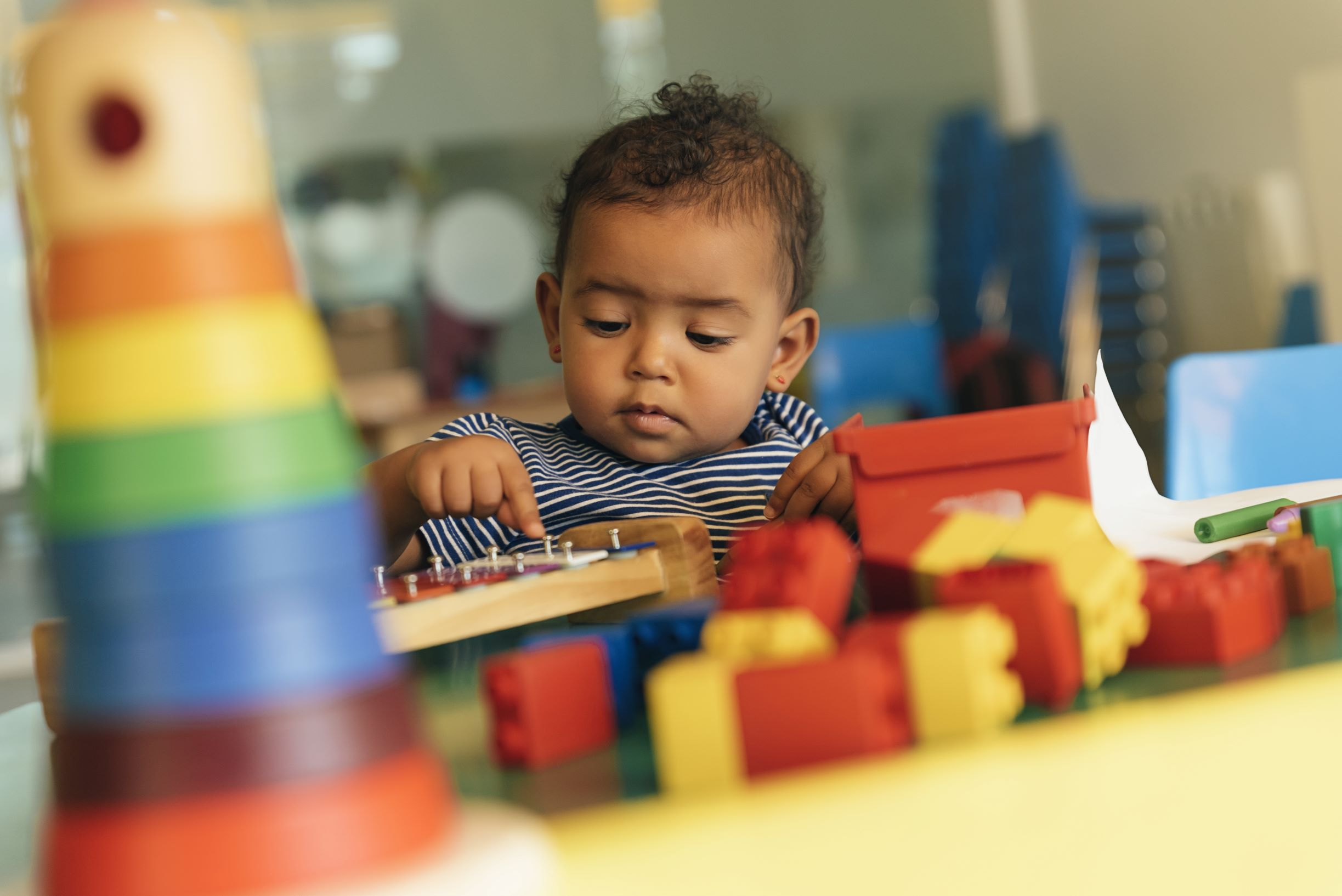 Child with colored blocks